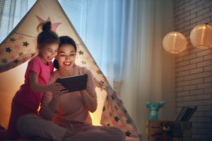 Mom and daughter watching tablet